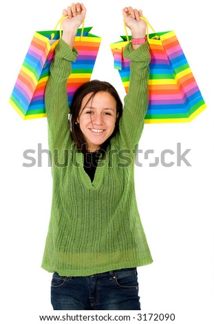 happy girl with shopping bags over a white background