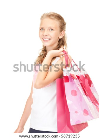 happy girl with shopping bags over white