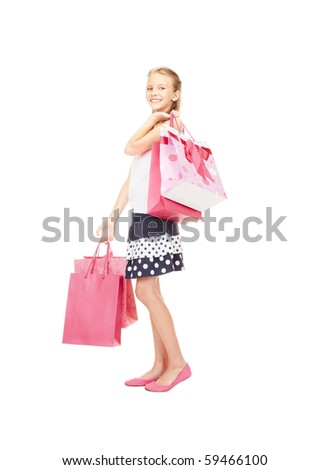 happy girl with shopping bags over white - stock photo