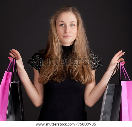 Happy girl with shopping studio photography - stock photo