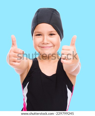 Happy girl with snorkel equipment, over blue background - stock photo