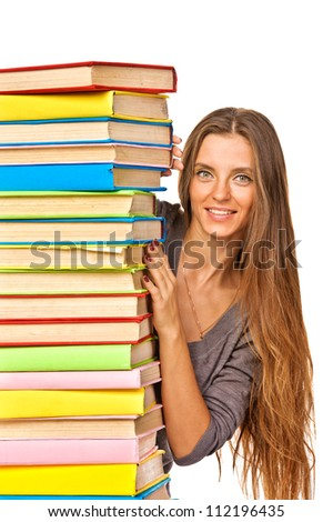 Happy girl with stack color books. Isolated over white