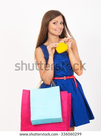 Happy girl with the shopping bags and the small money purse - stock photo