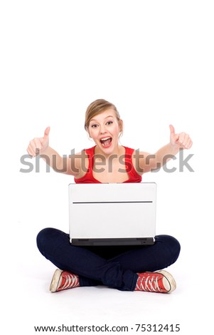 Happy girl with thumbs up using her laptop
