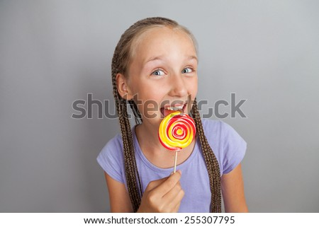 happy girl woman with lollipop - stock photo