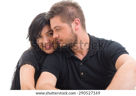 Happy girlfriend with handsome boyfriend isolated on white studio background - stock photo