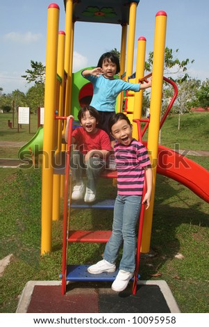 Happy girls and boy outing at the park - stock photo