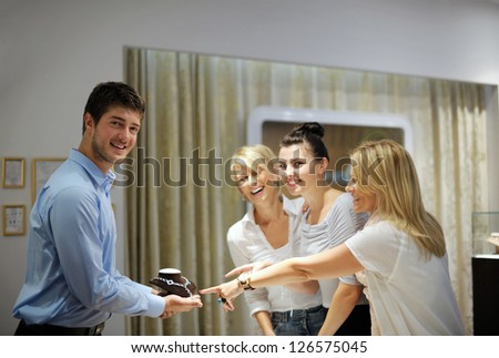 happy girls group  have fun while shopping in jewelry store - stock photo