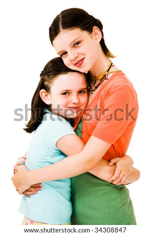 Happy girls hugging and posing isolated over white - stock photo