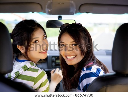 happy girls in the car and enjoy driving - stock photo