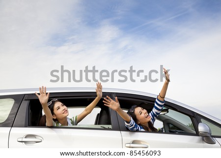 happy girls in the car and enjoy vacation - stock photo
