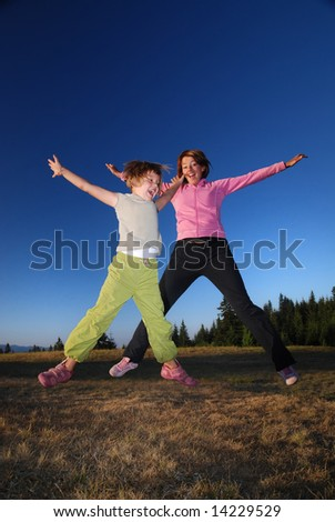 happy girls Jumping in to air - stock photo