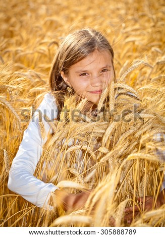 Happy girls meadow wheat field - stock photo