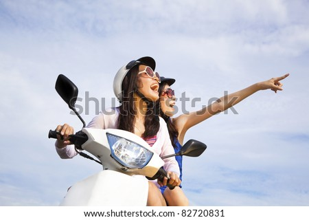 happy girls riding scooter enjoy summer vacation - stock photo