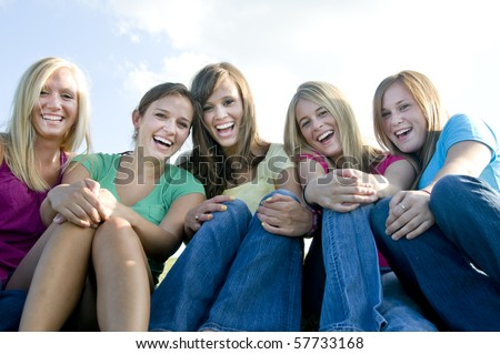 Happy girls sitting together and laughing