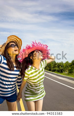 happy girls watching the sky and enjoy summer vocation - stock photo