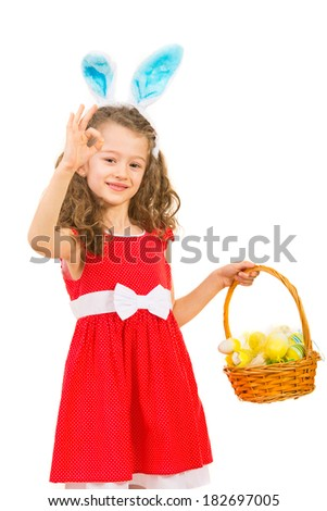 Happy girls with bunny ears and Easter basket showing okay sign hand gesture isolated on white background - stock photo