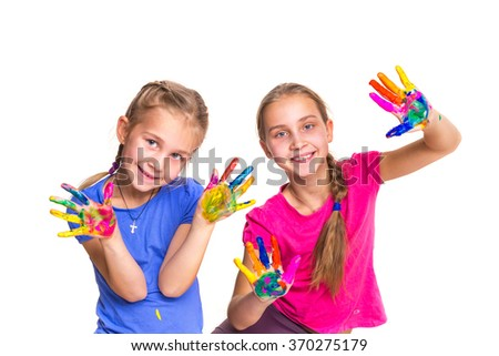 Happy girls with hands in paint isolated on white. Art concept