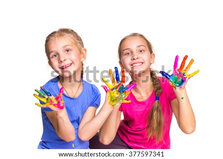Happy girls with hands in paint isolated on white. Art concept - stock photo