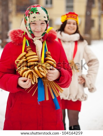 Happy girls with  round cracknel during  Shrovetide in Russia