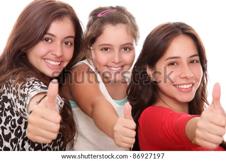 happy girls with thumb up isolated over white background - stock photo