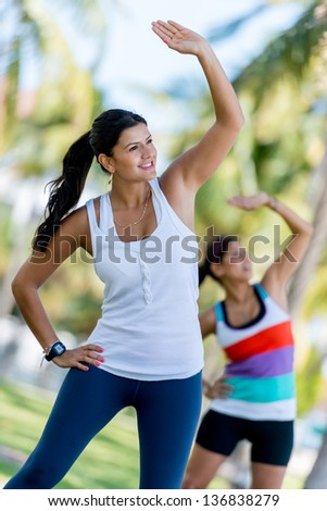 Happy girls working out outdoors at the park - stock photo