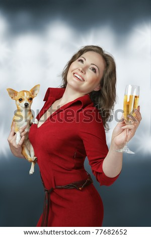 Happy glamour woman with champagne and small chihuahua dog - stock photo