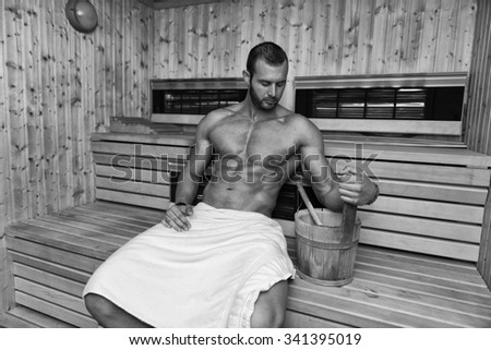 Happy Good Looking And Attractive Young Man With Muscular Body Relaxing In Sauna Hot - stock photo