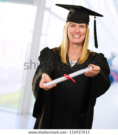 Happy Graduate Woman showing Certificate against an abstract background
