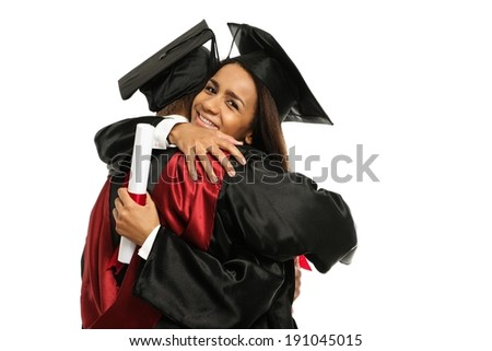 Happy graduated young multi ethnic students couple hugging  - stock photo