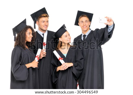 Happy graduates. Group of young attractive students taking selfie together. Isolated on white.