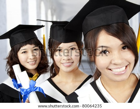 happy graduation asian girls - stock photo