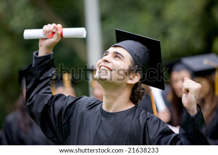 happy graduation student full of success outdoors - stock photo