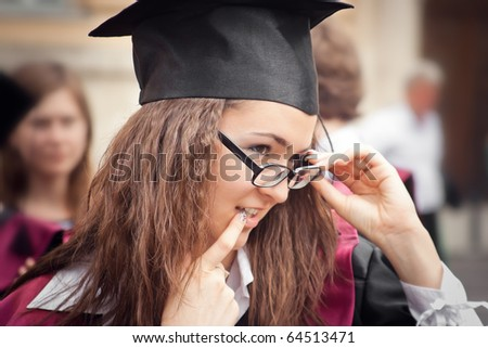 Happy Graduation Student smiling outdoors - stock photo