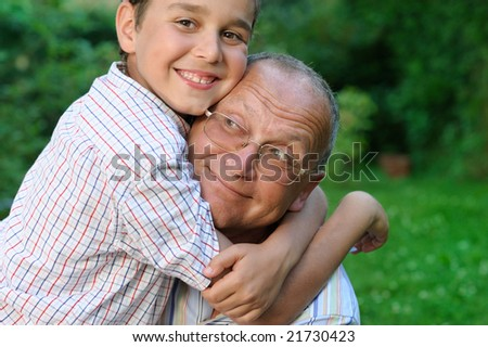 Happy grandfather and grandson outdoors - stock photo