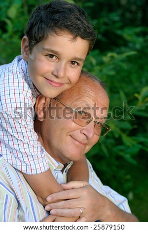 Happy grandfather and kid outdoors - stock photo
