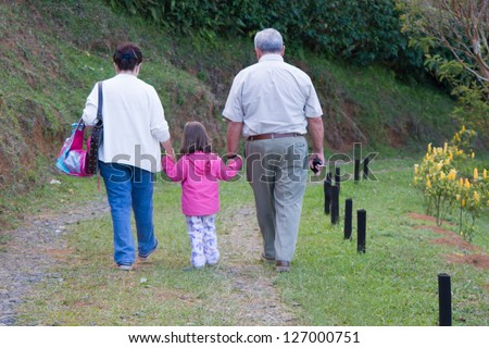 Happy Grandfather, Grandmother and grandchild, Enjoying At The Park - stock photo