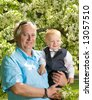 Happy grandfather with his grandson outdoors - stock photo