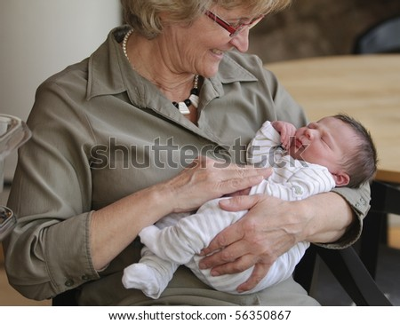 Happy grandma with newborn baby