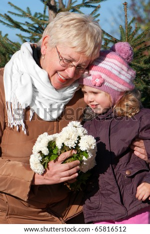 happy grandmather and granddaughter in park - stock photo