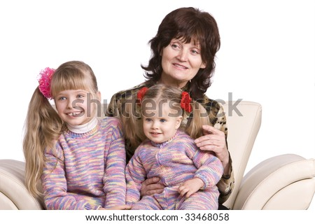 Happy grandmother and two granddaughter.Isolated.