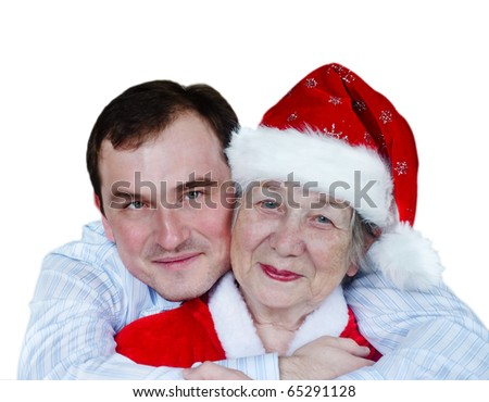 Happy grandmother in Santa hat and grandson