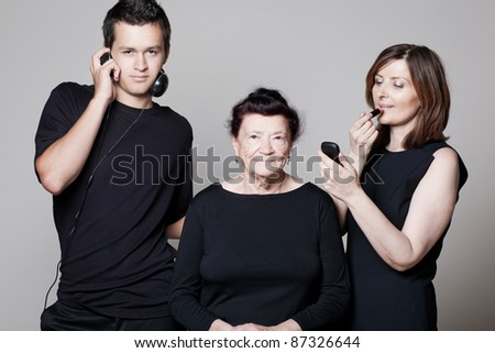 Happy grandmother with adult daughter and grandson. - stock photo