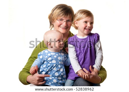 Happy grandmother with her granddaughters - stock photo