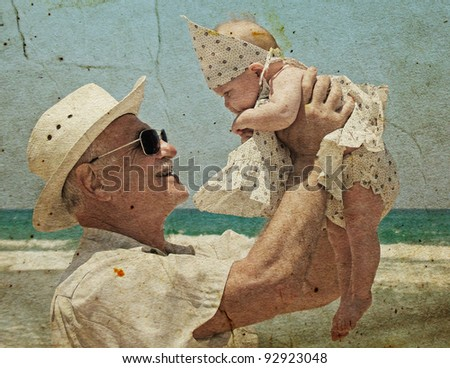 happy grandpa is holding a little granddaughter. Background - the sea.  Photo in old image style. - stock photo