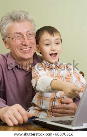 happy grandparent with their child play on the computer - stock photo