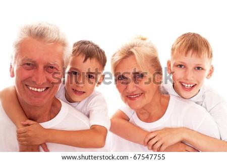 happy grandparents with grandchildren on a white - stock photo