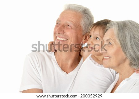 Happy Grandparents with little girl isolated on white