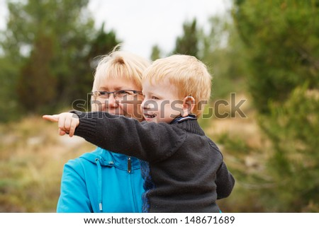 Happy  grandson having fun with his grandmother - stock photo