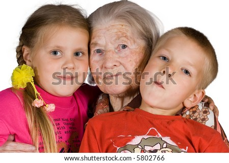 Happy grandsons sit with the grandmother - stock photo